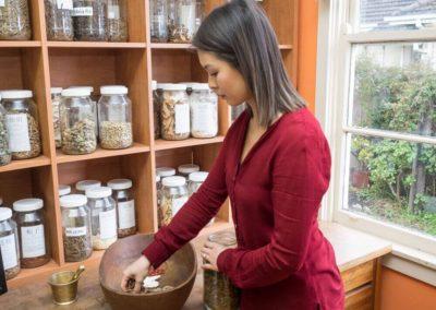 Dr Vivian Tam preparing Chinese herbs